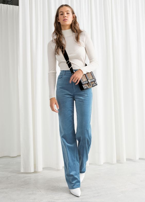 Model front image of Stories velvet cuffed trousers in blue