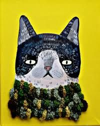painted cat wearing a sweater
