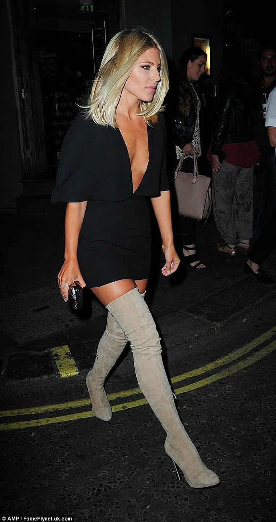 Work it: The Saturdays star strutted into the bash in a tiny black mini dress and racy thigh-high boots