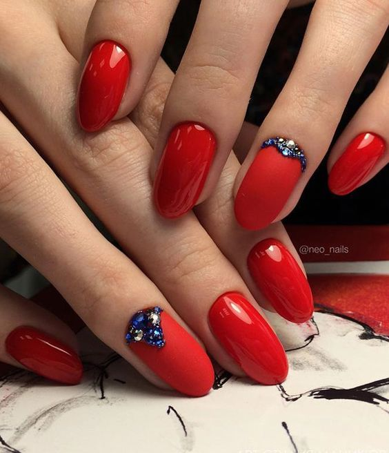 Combination of shiny and matte red is very nice and blue rhinestones give extravagant note.:
