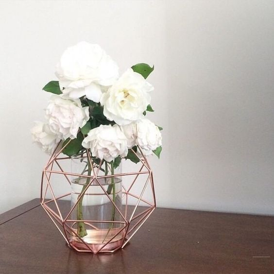 Roses and rose gold. Beautiful bouquet delicately placed on floor next to sink: