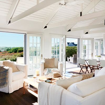 """""""Painting the interior, including the architectural elements, made a huge impact,"""" he says. """"It was like a night-and-day difference. It now feels clean, airy, and beachy."""""""