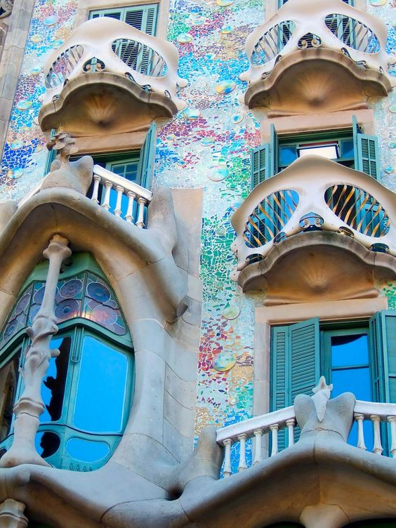 I WILL see this incredible building someday- I just love the way Gaudi designed it to have the tiles resemble aquatic scales... and the colors!  Oh, Spain- I need to see you now!