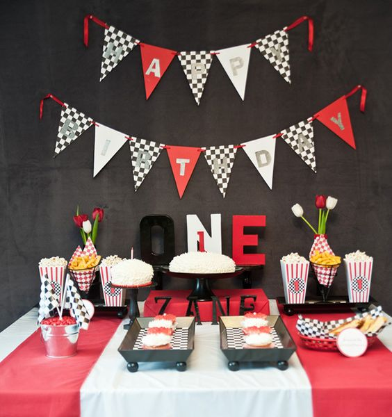 Here is a round up of 8 cute boy 1st birthday party themes from around the web. These first birthday themes are cute and over the top for your baby boy!