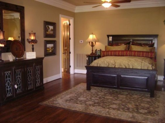 Dark furniture gold and red bedding with gold walls and Dark paint colors for bedrooms