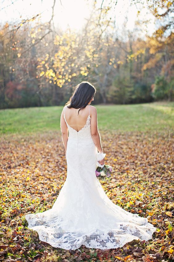 Simple low back lace wedding dress with flowy train.   Photography: CWF Photography - www.cwfphotography.org  Read More: http://www.stylemepretty.com/2014/07/22/autumn-wedding-in-the-appalachian-foothills/