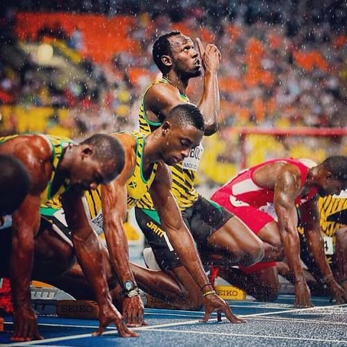 Fastest Man....Usain Bolt! Everyone gets ready to run and Usain is praying before he runs to help him do well in the 100m. That's what I love about him!