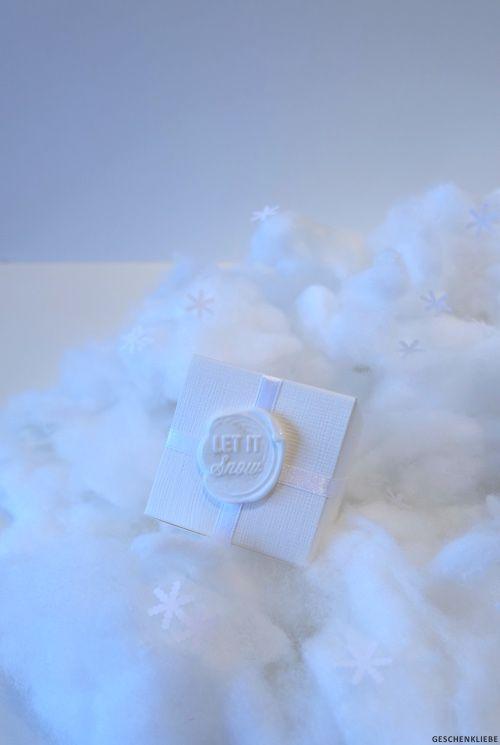 "Geschenkverpackung mit Siegelstempel ""Let it snow"""
