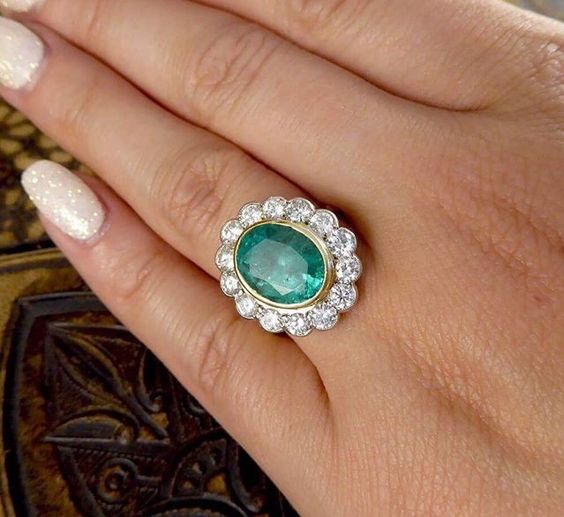 Divine emerald and diamond halo estate ring