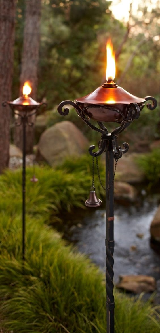 Handcrafted in pure copper and sturdy iron our gorgeous for Outdoor tiki torches