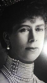 Queen Mary wearing the pearl button earrings in the late 1890. These are the same earrings the Queen wore to the Epsom Derby.