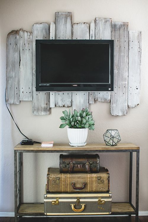 old wood behind the tv on the wall -love this idea to help dress up