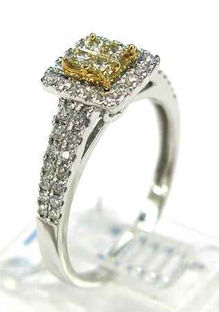 Ladies 14kt white gold diamond ring. Ring is set with 4 princess cut natural yellow diamonds and 44 brilliant round white cut diamonds. A total of approximately .55ct.
