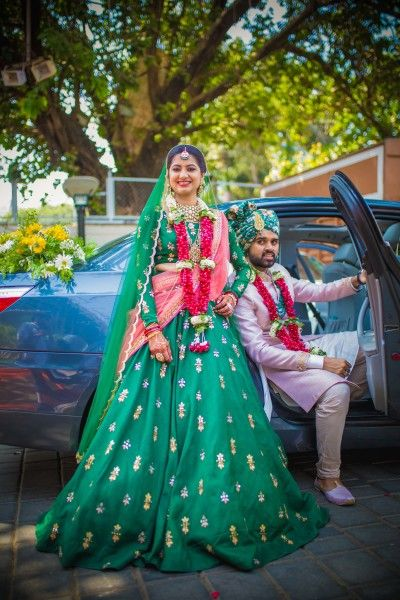 Bridal Lehenga - Bride in a Emerald Colored Lehenga with Golden Embroidery and a Pink Dupatta | WedMeGood #wedmegood #Indianbride #weddinglehenga #lehenga #green #emeraldgreen #embroidered #lehenga