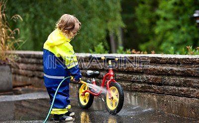 Boy washing bicycle photo