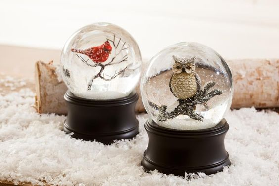 Featuring charming holiday figures in elegant clear glass spheres, our snow globes capture the beauty and elegance of a wintry wonderland.