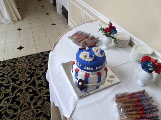 Baseball baby shower cake table with cake and chocolate dipped pretzels. I had a separate dessert table no one took a photo of = (