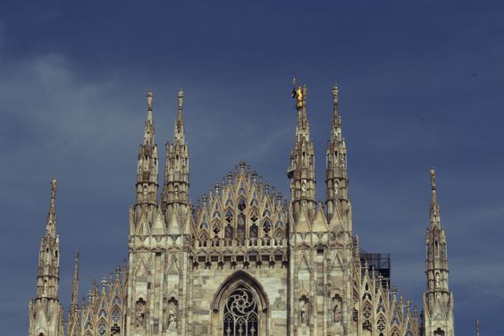 https://flic.kr/p/td6B6i | Duomo cathedral | The top of the Duomo cathedral in Milan, Italy, touching the clouds. Took a staggering 6 centuries to complete, its the 5th largest church in the world and the largest in Italy.