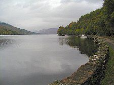 Loch Arkaig is looking likely as a 'visual' location - long and narrow.  http://streetmap.co.uk/grid/209500_790437_106 - gives a good idea