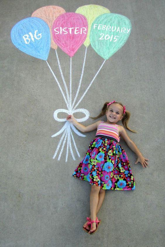 30+ Fun Photo Ideas to Announce a Pregnancy - Sidewalk Balloon Chalk Announcement