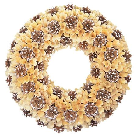 Deck your halls in holiday cheer this season with this lovely wreath. Perfect for welcoming guests on the front door, this festive essential features snow-du...