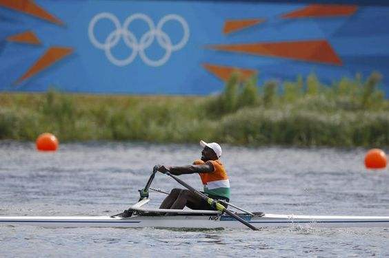 You can do it: Niger's Hamadou Djibo Issaka brings up the rear in the men's single sculls repechage at Eton Dorney