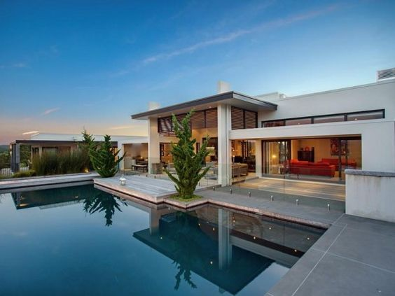 Contemporary hill home with beautiful gardens and pool for Pool design mcmurray