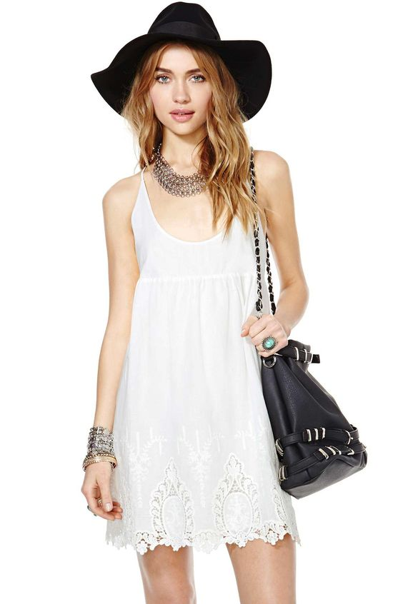 You can never have too many white dresses in your warm weather wardrobe! This amazing one feature...