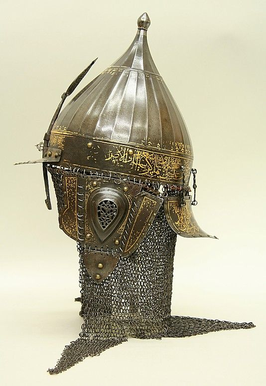 This helmet was forged from watered steel and decorated in gold with arabesques…