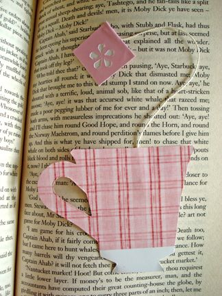 Tea Cup Bookmark- I drew out a pattern and then cut out two of them in scrapbook paper. Then I used an actual tea bag string and glued it in between the two pieces.: