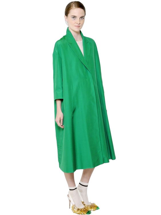One concealed snap button closure. Three quarter length sleeves. Oversize fit. Silk lining. Made in Italy . Sample size: 40