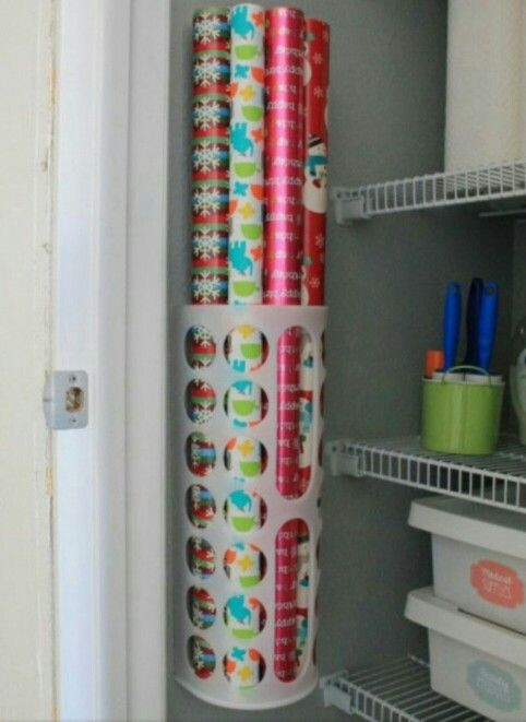 Use a plastic bag holder (Ikea, $1.50) to attach to the wall of a closet to store wrapping paper tubes or yoga mats off the floor.