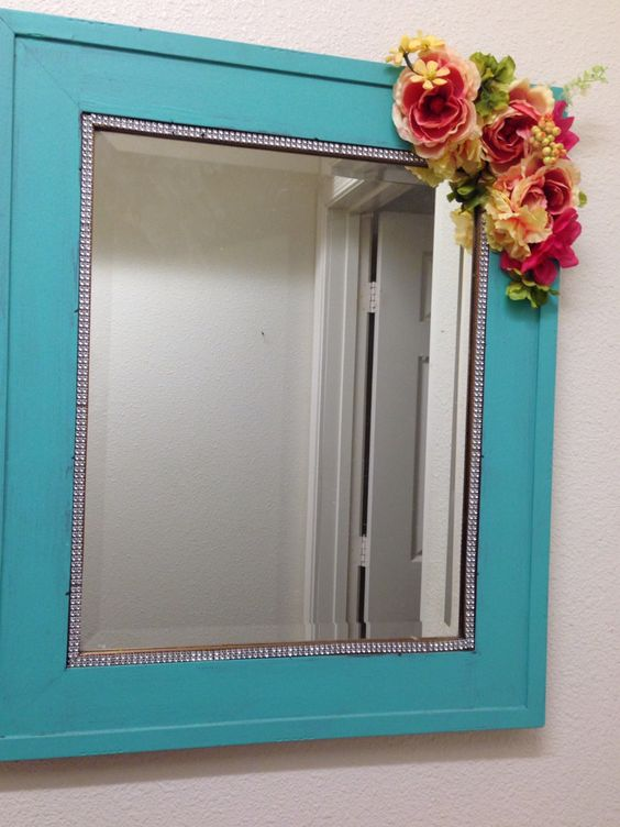 This was an old mirror we had at home, I decided to add a few things to it.