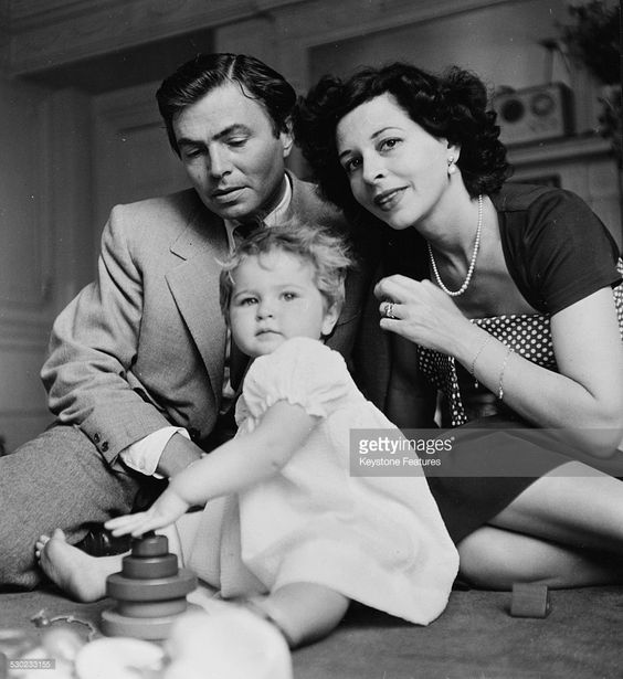 Portrait of actor James Mason, with his wife Pamela and daughter Portland, circa 1949.