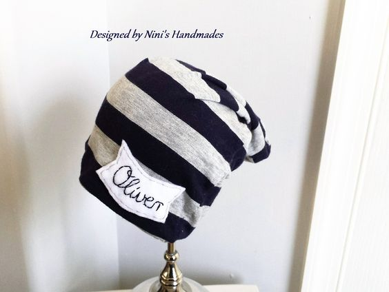 You will be able to leave the Name at the checkout messaging box!!! The Jersey Knit Navy and Grey striped slouchy above is handmade and embellished with my own felt design. This Hat was handmade in a