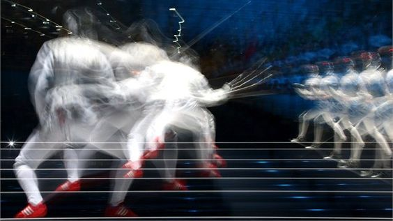 Valentina Vezzali of Italy competes against Arianna Errigo of Italy during their women's Foil Individual Fencing semi-final match