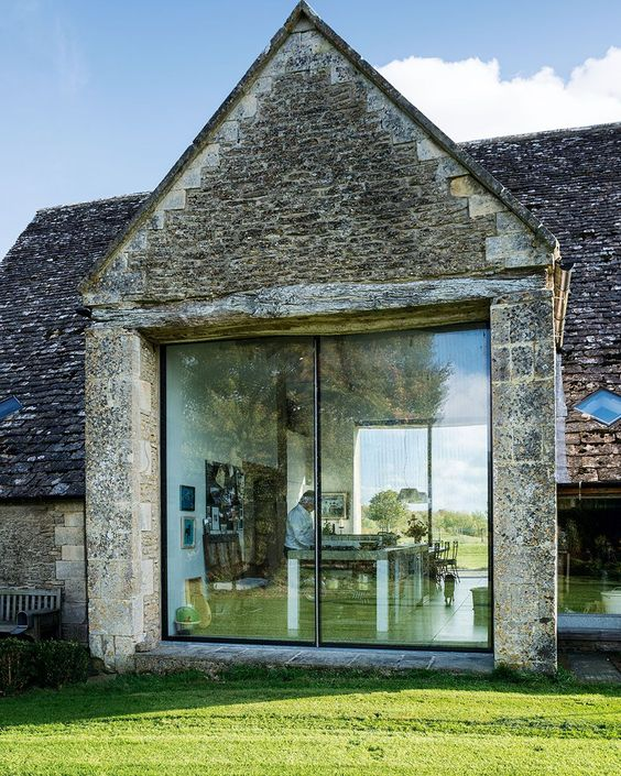 An agricultural barn has been lovingly converted to create a charming family home