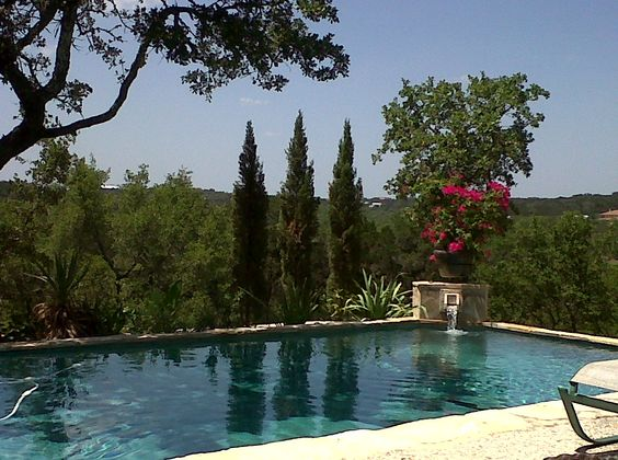 A Little Bit Of Italy With Italian Cypress Trees Adorning The Texas Hill Country Pool Landscaping Italian Cypress Trees Hill Country Homes