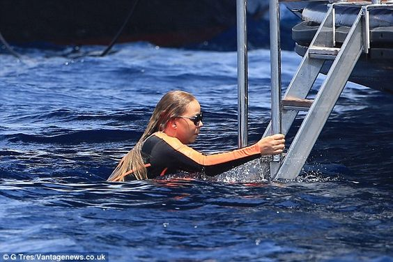 Short and sweet: The mother-of-two was immediately spotted climbing back up the yacht's ladder after hopping into the water