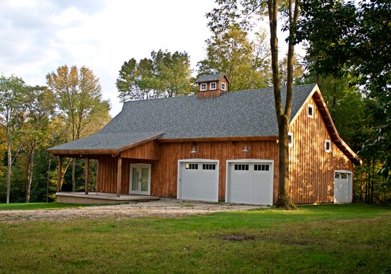 Barn Home with attached garage.  Creative Design on the garages.  www.sandcreekpostandbeam.com https://www.facebook.com/pages/Sand-Creek-Post-Beam-Traditional-Post-Beam-Barn-Kits/66631959179