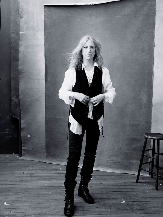 Patti Smith is as cool as ever in her white-blouse-black-vest stage attire by Annie Leibovitz  for Pirelli Calendar.