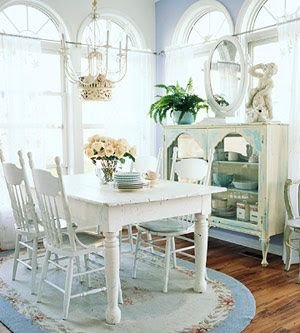 Antique white Country Coastal Cottage style dining table. Not certain about the chairs. I am leaning more towards fabric.