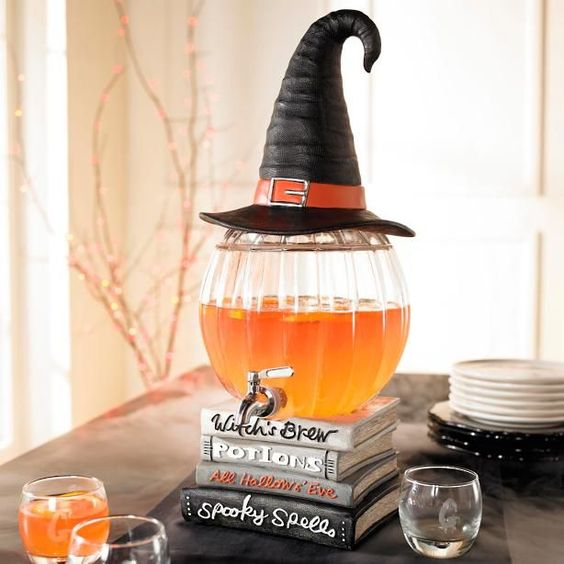 Cast some well-crafted hocus pocus over your next bewitched buffet. Our Witch's Brew Entertaining Collection includes a Three-tiered Serving Tray, Serving Cauldron, Pumpkin Beverage Dispenser, and Snack Bowl Stand entire repertoire of serving sorcery, all a little more delightful than dreadful. In crisp and graphic black, white, and orange. Food-safe. Decorative broom elements feature realistic, cast iron handle and plastic bristles. Simple assembly for some pieces. ...