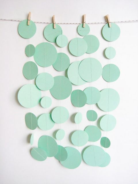 Celadon green circle garlands could make a fantastic backdrop for a photobooth at a celadon green wedding.