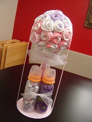 Baby sock topiary....Another alternative to the diaper cake.