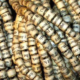 word beads: take a paperback book, tear out the pages, cut pages in strips horizontally with an exacto knife, trim the edge of a strip you want to use so a word shows, wet the first inch of the other end of the strip with water, wet the toothpick, mod podge both sides, twirl the strip, press end tight for a moment, coat with more mod podge, stick toothpick in scrap styrofoam to dry, remove bead using needle nose pliers and, voilà! you can watercolor the page if you want colored beads, too!