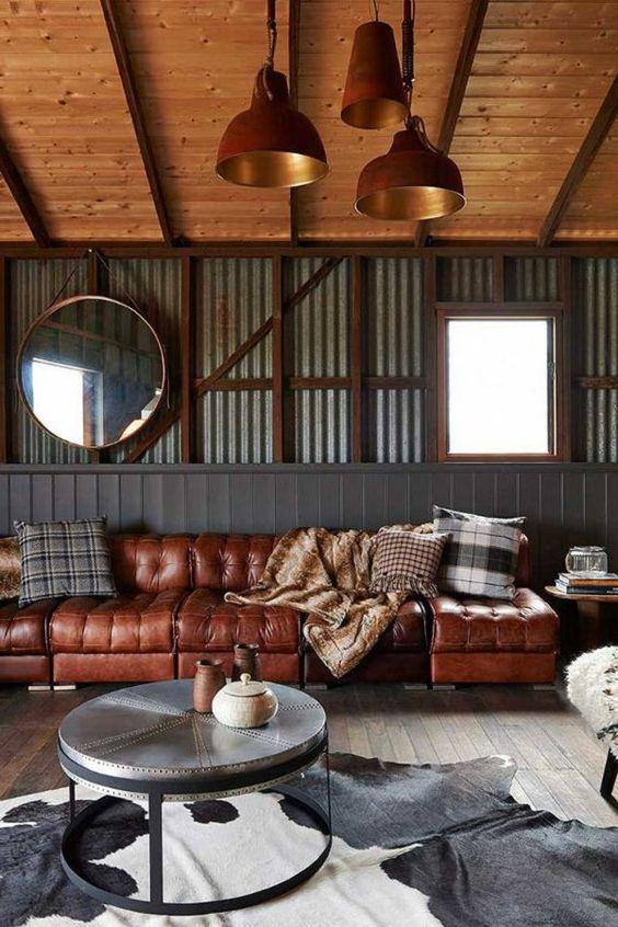 hangar amenage canape en cuir miroir rond table rond tapis table de chevet