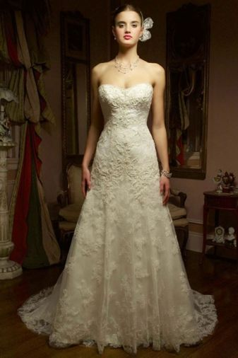 Casablanca Bridal - Crystal. This romantic gown has a modified sweetheart neckline and an A-line silhouette. The delicate lace is decorated with just the right amount of sparkle and beadwork.