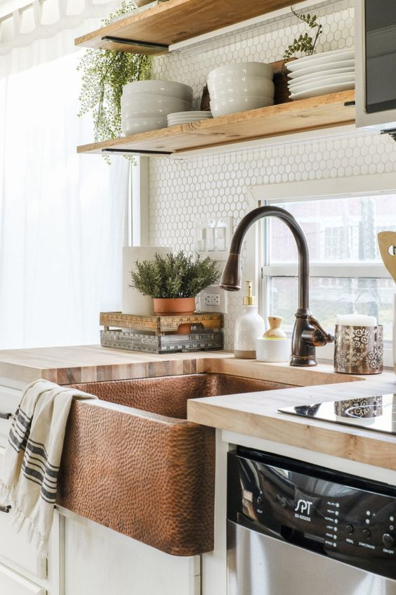 RV kitchen with a copper sink and butcher block counter tops