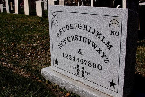 The grave of Elijah Jefferson Bond is marked by a Ouija Board headstone at Greenmount Cemetery in Maryland. Elijah Bond was best known for filing the first US patent for the Ouija Board. Elijah Bond died in 1921 and was anonymously buried in his family's plot. Robert Murch, America's foremost Ouija historian, located the ambiguous grave and erected the Ouija-themed headstone in 2008.